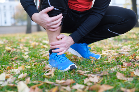 Injury running concept . Man having knee pain while training because overtraining Stock Photo