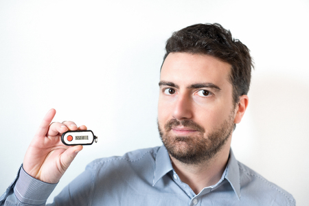 Man holding a security banking pin generator Stock Photo