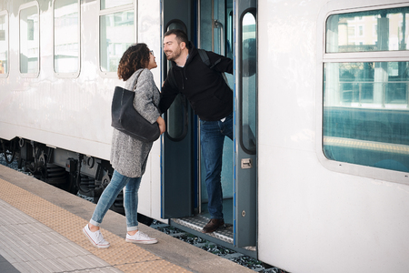 Love couple hugging before leaving on the train