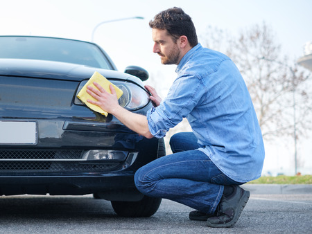 Man taking care and cleaning his new car Stockfoto
