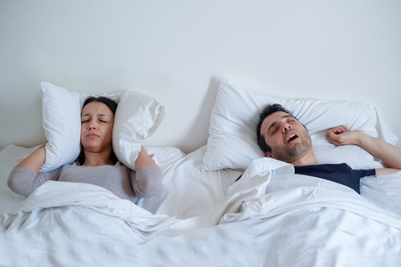 Woman can't sleep because her boyfriend is snoring loudly
