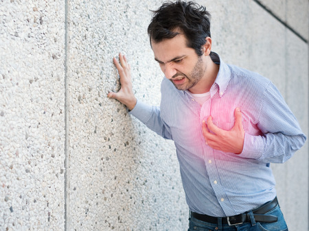 Man having a sudden heart attack and feeling bad