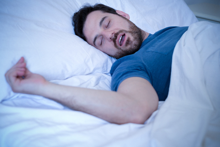 Snore problem concept.Man in bed snoring and sleeping Stockfoto