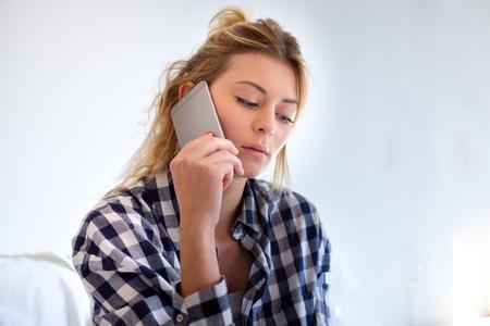 Girl sad hearing bad news by the phone
