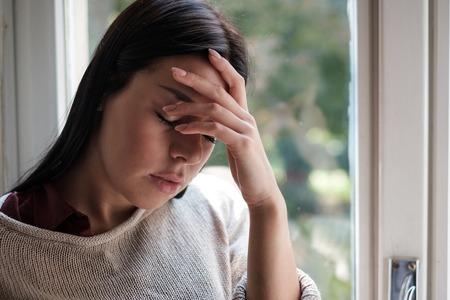 Woman feeling bad headache with head in hand Imagens - 115533194