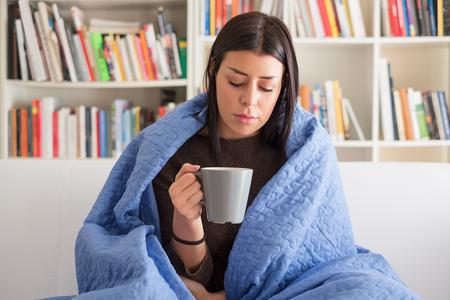 Woman feeling sore throat drinking hot drink Stock Photo