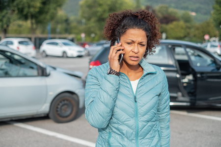 Woman call roadside service after fender bender car crash Stock Photo
