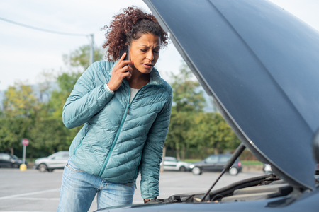 Calling roadside service after car engine breakdown Reklamní fotografie