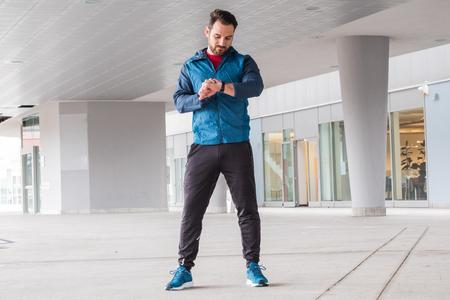 Active man portrait using smartwatch fitness app