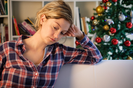 Sad christmas days for lonely woman at home Stock Photo