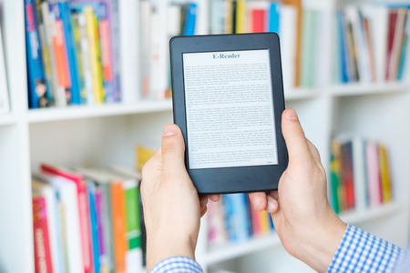 Choosing a buying book and internet book store concept Imagens