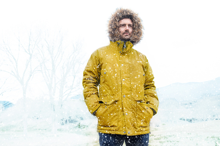 Man in cold and snowy weather storm in winter