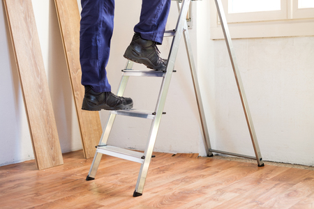 Home renovation and repairing concept with ladder on parquet floor Standard-Bild - 119077612