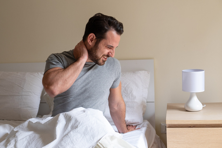 Man waking up in the morning and suffer for neck pain Stock Photo