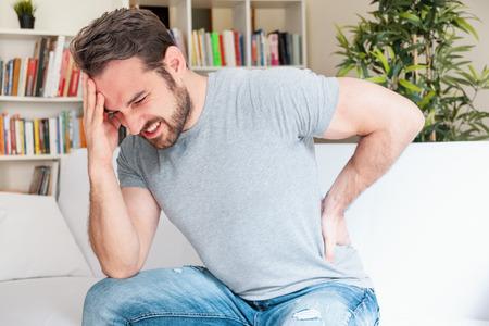 Man portrait feeling bad for painful backache