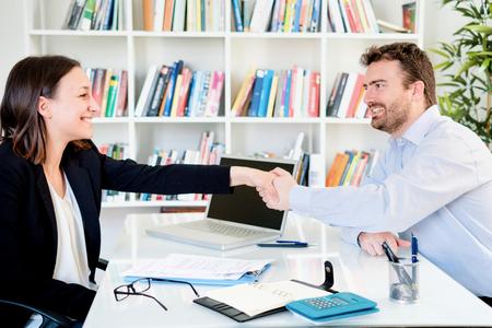 Business handshake after a good insurance agreement