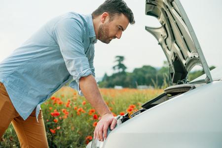 Stressed driver after car breakdown calling roadside service Reklamní fotografie