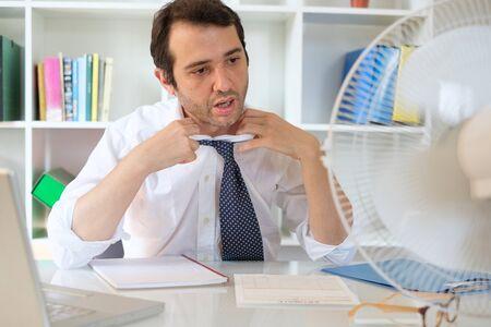 Office employee feeling stressed after summer heat haze