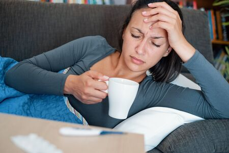 Young ill woman suffering influenza and bad flu Stockfoto - 132028510