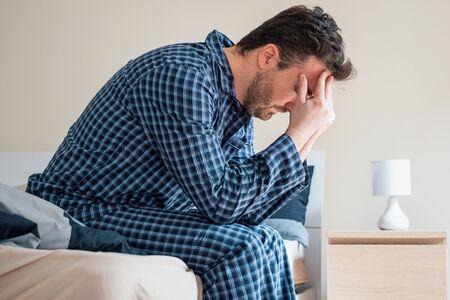 Man having problem sleeping in his bed Stock fotó