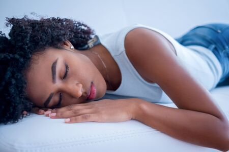 Tired afro american woman portrait on the sofa Stockfoto