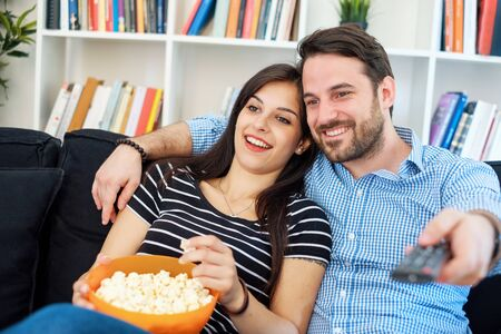 Portrait of young loving couple in living room