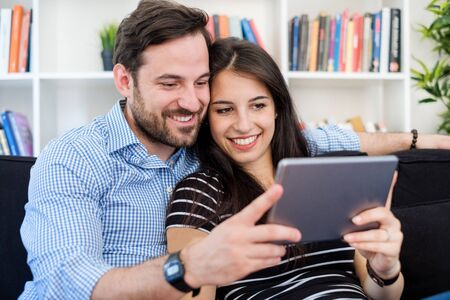 Young couple watching internet media content on digital tablet Stockfoto