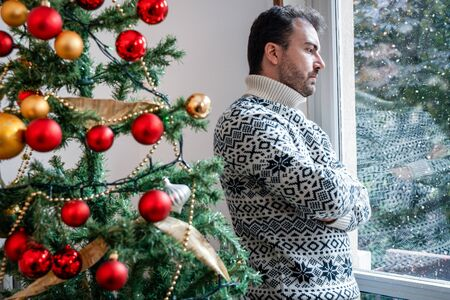 Man solitude portrait feeling bad during christmas day