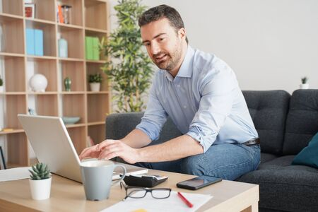 One guy working from home using internet connection Stock Photo