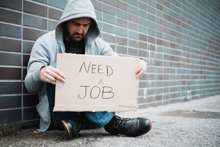 Jobless guy looking for a job and begging in the streets