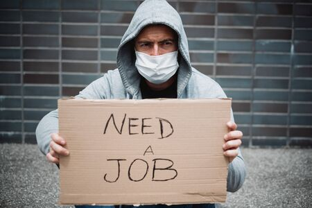 Jobless guy looking for a job and begging in the streets during covid-19 recession