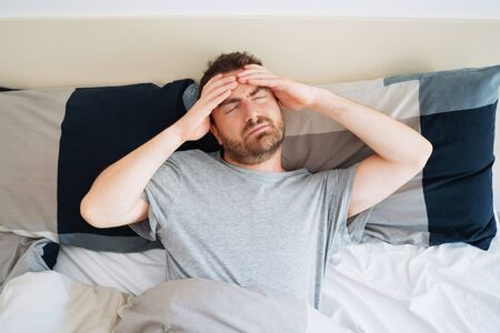 Man having trouble with sleep and trying to sleep