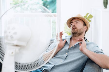 Man sweating and trying to refresh in summer haze