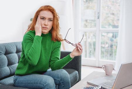 Woman portrait suffering eyestrain and head pain