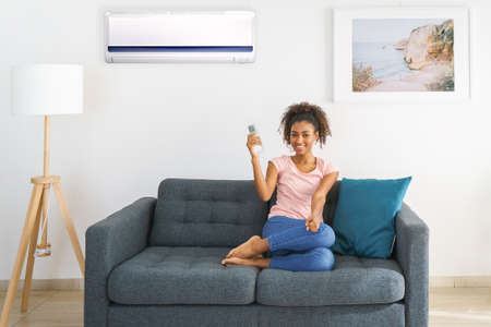 Black woman relaxing under the air conditioner