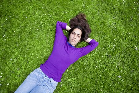 young girl relaxing on the grass Stock Photo - 7556215