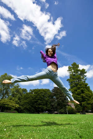 young girl dancing happy in a park Stock Photo - 7556212