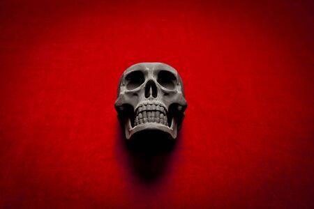 black scary human skull on red velvet background Stock Photo - 9733770