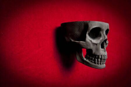 black scary human skull on red velvet background Stock Photo - 9733813