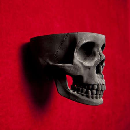 black scary human skull on red velvet background Stock Photo - 9733665