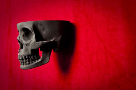 black scary human skull on red velvet background Stock Photo - 9733905