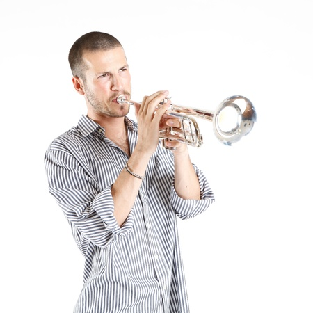 saxophones: young man playing the trumpet