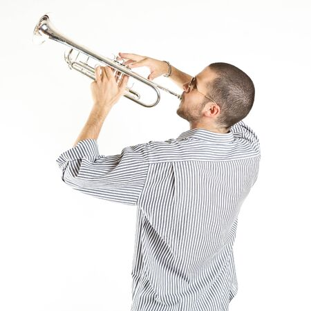 young man playing the trumpet photo
