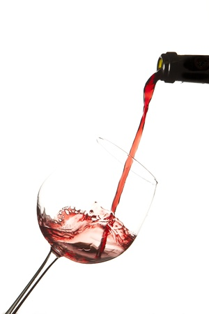 Red wine splash on a glass, white background.