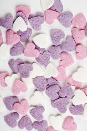 heart shaped candy sweets on white background photo