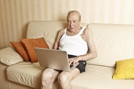 elder man with laptop Stock Photo - 9841064