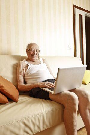 elder man with laptop Stock Photo