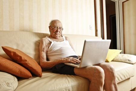 elder man with laptop Stock Photo - 9841063