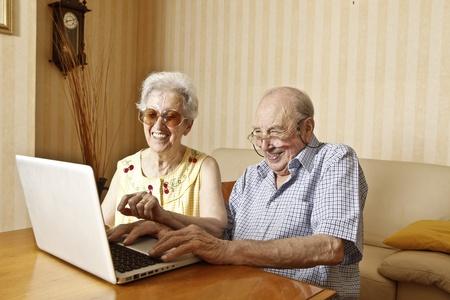 elderly couple with laptop photo