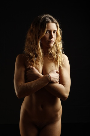 portrait of beautiful nude young girl on black background Stock Photo - 9841784